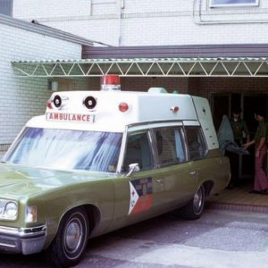 Pontiac Superior Ambulance at an area hospital.  Early uniforms were simply kelly green shirts and bell bottoms... Notice that this unit had only one